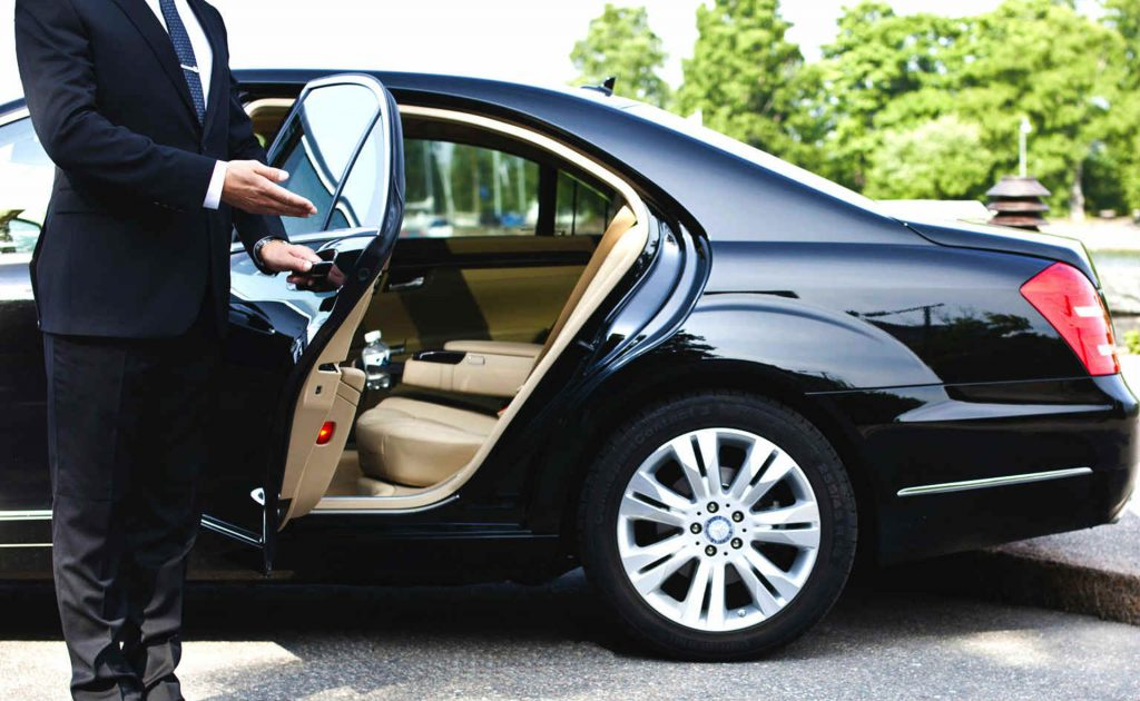 chauffeur - limo - luxury limousine- black suit - limo on demand